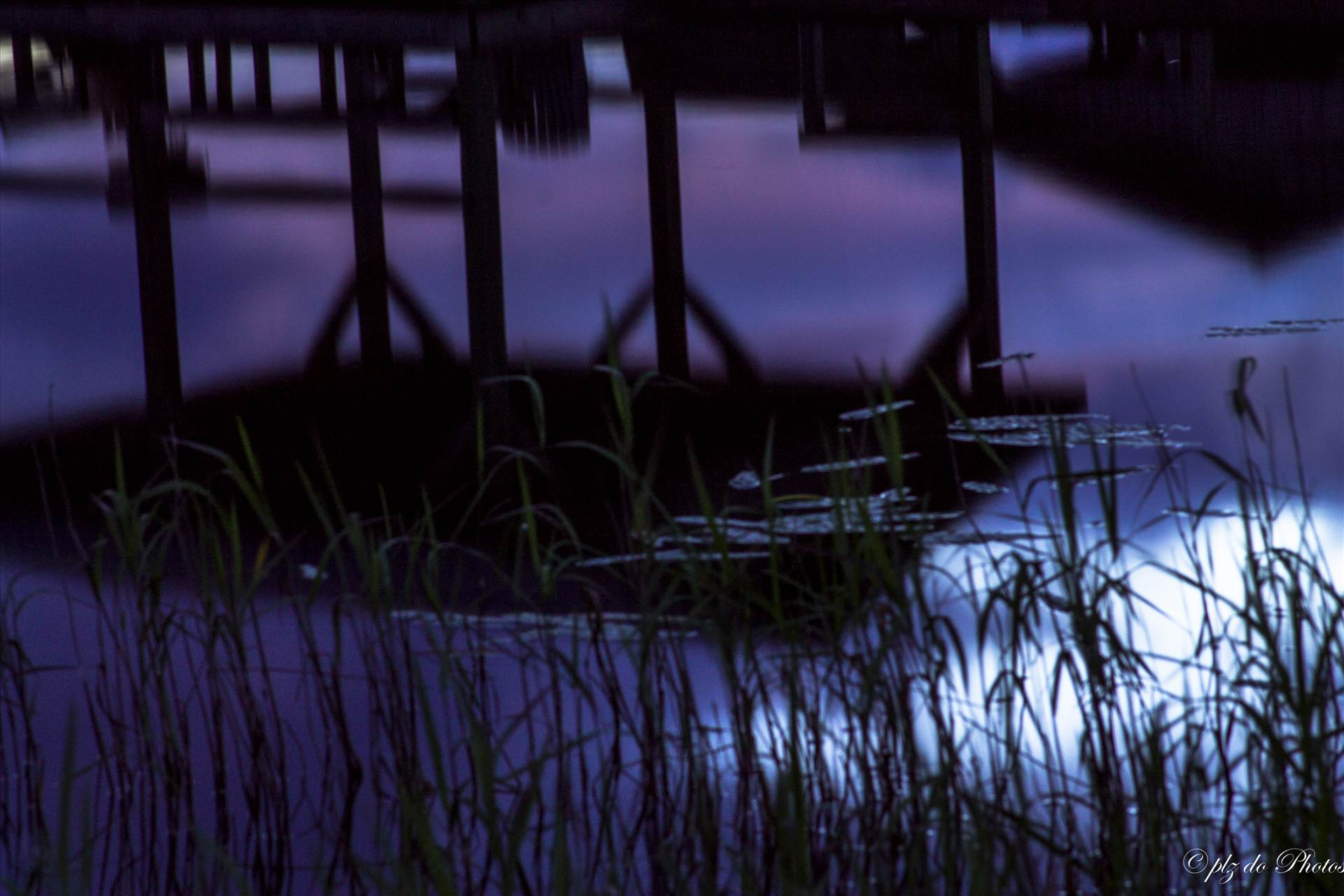 Purple Haze - Reflection of late sunset in June at Lake Waccamaw, NC by Patricia Zyzyk