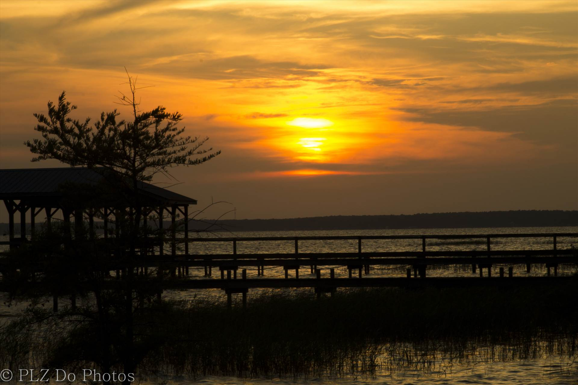 GOLDEN LAKE WACCAMAW - The golden hour - sunset at Lake Waccamaw, NC by Patricia Zyzyk